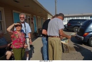 77 9sl. Thermopolis El Rancho Motel - eclipse friends - - Louise, Howard and others reading a map