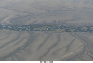 114 9sl. aerial - Riverton to Rock Springs - winding river in wide wash