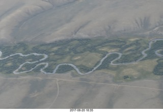116 9sl. aerial - Riverton to Rock Springs - winding river in wide wash