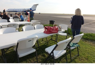 29 9sm. Riverton Airport - airplane and chairs