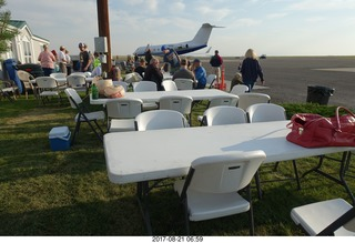 30 9sm. Riverton Airport - airplane and chairs