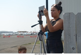 44 9sm. Riverton Airport - lady taking eclipse pictures
