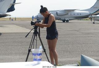 55 9sm. Riverton Airport - lady setting up her camera